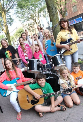 School of Rock in Strathroy:  Front, left to right: Martin Van Meurs, Chelsea Berg, Tony Van Meurs. Second row, left to right: Mallory Heslinga, Claire Shaw, Tori Vanderwal. Back row, left to right: Eric Berg, Catherine Almeida, Kurtis Berg, Breece Andrade,Dan Bolton, Lauren Berg. ELENA MAYSTRUK/AGE DISPATCH/QMI AGENCY