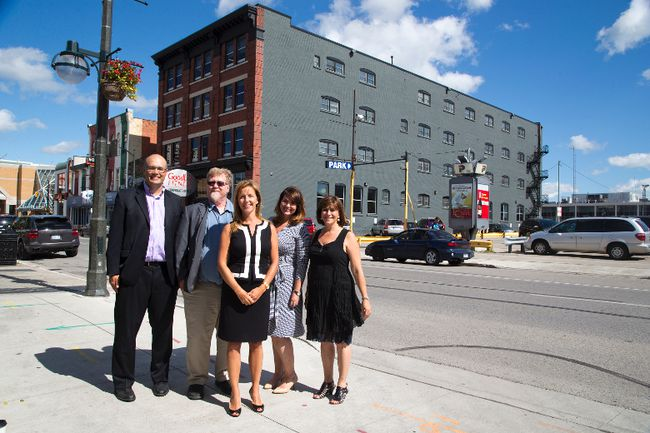 Pillar Non-Profit partners David Billson, left, Sean Quigley, Michelle Baldwin, Andrea McNaughton and Lina Bowden. Pillar has purchased GoodLife Fitness's headquarters at 201 King St. in London. (Free Press file photo)