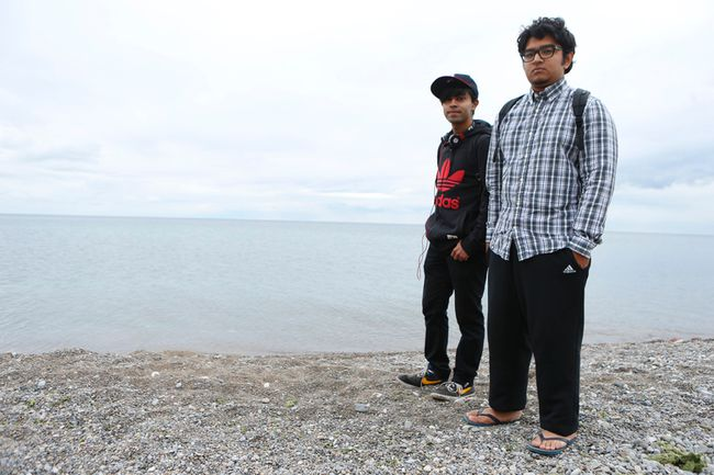 Toronto friends Ashif Ahmed, 18, (L) and Tashpi Rahman, 19, pictured Thursday, August 14, 2014, near the R.S. Harris Harris Water Filtration plant in the east end of the Toronto Beach area where they set off in a dinghy Wednesday. (Jack Boland/Toronto Sun)