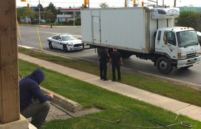 A cyclist, 69, was killed Friday morning when he collided with a truck at a Mississauga intersection. The truck's driver was visibly distraught as Peel Regional Police investigated. (CHRIS DOUCETTE/Toronto Sun)