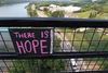 A homemade sign attached to the High Level Bridge in Edmonton Alta., on Friday Aug. 15, 2014. David Bloom/Edmonton Sun/QMI Agency