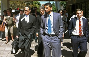 Dr. Khurram Sher walks outside the Ottawa Courthouse after being acquitted of terror conspiracy charges. At left is his lawyer, Michael Edelson. (TONY SPEARS Ottawa Sun)