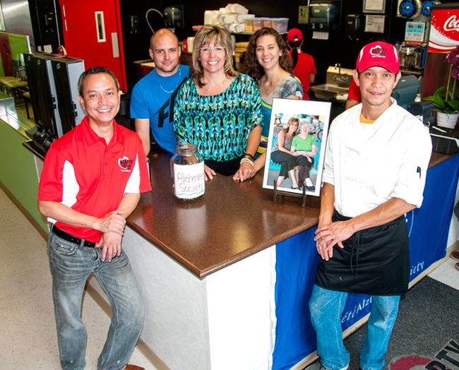 "Gerald Titong and Ronnie Zabala (front) were joined by Dustin, Joanne and Kristen Belke at Whitecourt's Hearty Fusion Express to pay tribute to ""Momma Ann"" by donating Aug. 13's sales to the Alzheimer's Society. Bryan Passifiume photo 