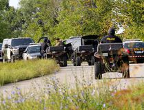 An OPP tactical search team assembles with ATVs on Howe Road, near Brockville, Ont., on Wednesday morning. Police are searching the area for missing Sun Media sports editor Steve Pettibone. (Darcy Cheek/QMI Agency)