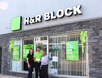Committee member Selwyn Hicks presents Dan and Karen Leitch of H & R Block with a cheque for $8,250 upon completion of its façade improvement project. When The Post originally printed the before and after pictures of the façades, H&R Block was inadvertently incorrectly identified.