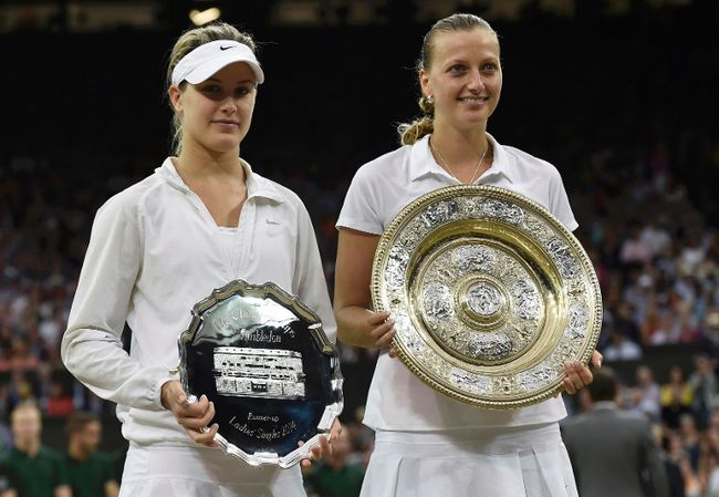 Eugenie Bouchard (L) of Canada holds the runner up trophy after being defeated by Petra Kvitova (R) of Czech Republic, holding the winner's trophy, the Venus Rosewater Dish, at their women's singles final tennis match at the Wimbledon Tennis Championships in London July 5, 2014. (REUTERS)