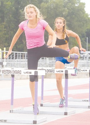 Lexi Aitken of Clinton, ON leads in hurdles during her final practice at the TD Stadium in London before heading to the 2014 Summer Youth Olympics in China.
