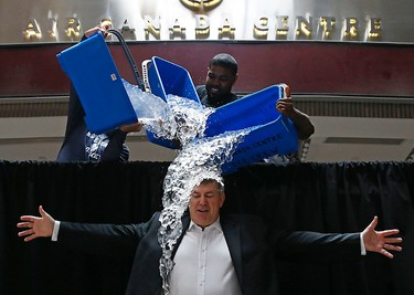 MLSE boss Tim Leiweke takes the ALS Ice Bucket Challenge with the help of from left up top, Nazem Kadri, Amir Johnson and Jermain Defoe at the Air Canada Centre in Toronto on Wednesday, August 20, 2014. (Michael Peake/Toronto Sun)