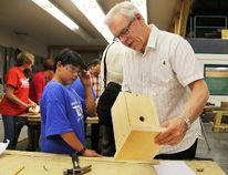 Premier Greg Selinger inspects a wren birdhouse built by Eleanor Prince, 12, during a visit to Portage Collegiate Institute on Tuesday. The Premier is on a skills and jobs tour supporting trades education among youth. (Svjetlana Mlinarevic/The Graphic/QMI Agency)