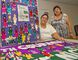 Sherry Lewis (left) manager of community programs at Brantford Native Housing, and Cynthia Barton, healing and wellness co-ordinator, show the local contributions to the Faceless Dolls Project. (Brian Thonmpson, The Expositor)