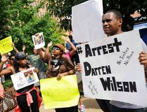 Protesters at the St. Louis County Justice Center call for the arrest of Police Officer Darren Wilson in Clayton, Missouri August 20, 2014. REUTERS/Mark Kauzlarich