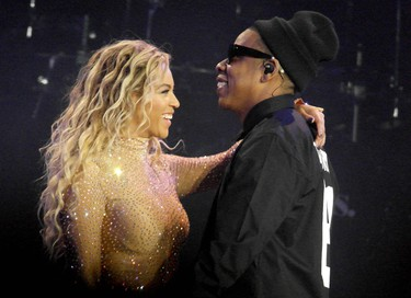 Jay Z joins Beyonce on stage during her 'The Mrs. Carter Show World Tour' concert at the O2 Arena, March 4, 2014. (WENN.COM)