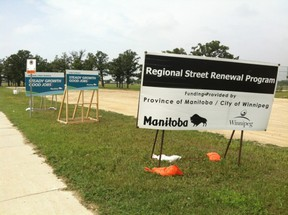 In this photo tweeted by Colin Craig, three provincial signs are up at a construction site. Tory leader Brian Pallister calls that a waste.