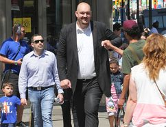 Canada's tallest man, Jerry Sokoloski at seven-foot-eight feet tall, towers over other pedestrians in Toronto on Tuesday, August 19, 2014. (STAN BEHAL/Toronto Sun)