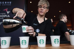 Sandy Roberts pours samples of Starbucks Reserve Sun Dried Ethiopia Yirgacheffe coffee during the company's annual shareholders meeting in Seattle, Washington in this file photo taken March 19, 2014. (REUTERS/David Ryder/Files)