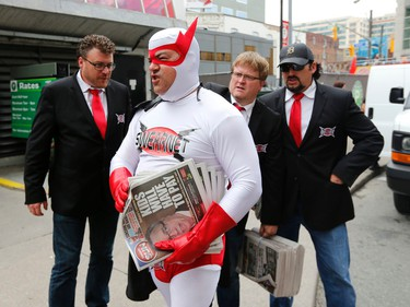 The Trailer Park Boys hand out free Toronto Suns at Dundas Square on Thursday, August 21, 2014. L-R Robb Wells, Patrick Roach, Mike Smith and JP Tremblay. (Michael Peake/Toronto Sun)