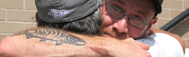 Colin Waring (right) hugs Ted Barnes at St. Vincent Place on Friday, Aug. 22, 2014.