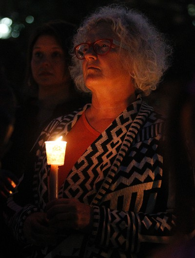 Edmonton-Strathcona MP Linda Duncan takes part in a candle light vigil at Sir Winston Churchill Square in Edmonton, AB on August 21, 2014 to remember missing and murdered Aboriginal women, most recently Tina Fontaine, 15, who was found wrapped in a bag and dumped in the Red River in Manitoba on Sunday. TREVOR ROBB/Edmonton Sun/QMI Agency