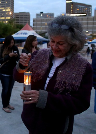 Marilyn Gaa ensures her candle is lit before taking part in a candle light vigil at Sir Winston Churchill Square in Edmonton, AB on August 21, 2014 to remember missing and murdered Aboriginal women, most recently Tina Fontaine, 15, who was found wrapped in a bag and dumped in the Red River in Manitoba on Sunday. TREVOR ROBB/Edmonton Sun/QMI Agency