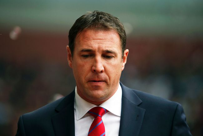 Malky Mackay apologized Friday after racist and homophobic texts by the former Cardiff manager were published in the Daily Mail. (Reuters)