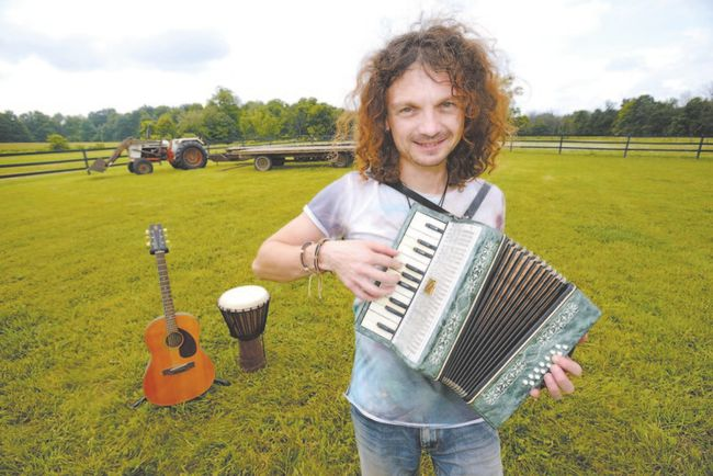 Musician Brent Jones is ready to roll the Back to the Garden Roots Music Festival on his family's farm near Dorchester. The third edition of the fest is Sunday, starting at 1 p.m. Jones will perform with five bands. (MORRIS LAMONT, The London Free Press)