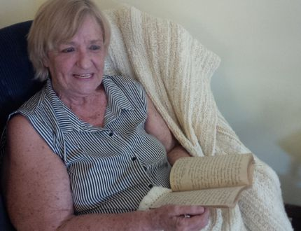 Robyn Knights holds the fragile diary she discovered among her father's belongings detailing the Japanese invasion in Papua New Guinea. (JANE SIMS, The London Free Press)