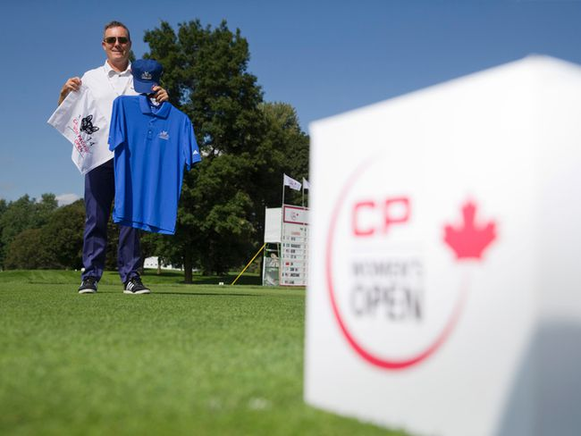London Hunt and Country Club head pro Tim McKeiver shows off some of the Canadian Pacific Women's Open merchandise for sale at the LPGA event being held at the golf club in London, Ontario on Friday August 22, 2014. (CRAIG GLOVER, The London Free Press)