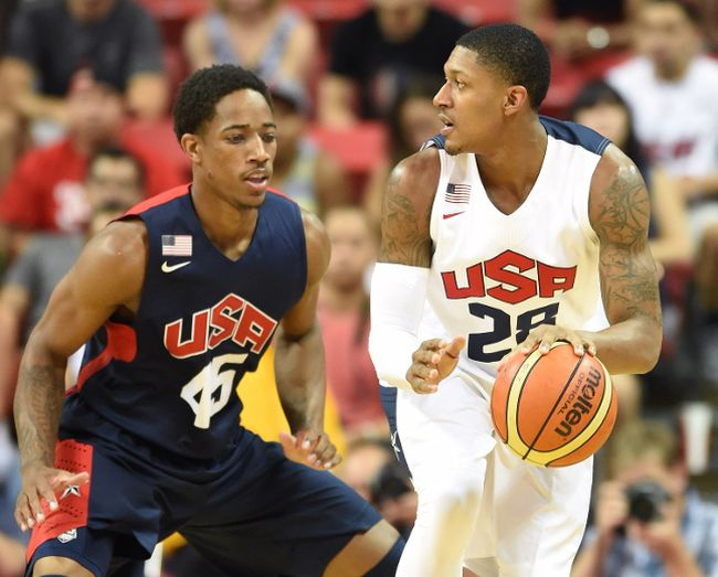 LAS VEGAS, NV - AUGUST 01: DeMar DeRozan #45 of the 2014 USA Basketball Men's National Team guards Bradley Beal #28 of the 2014 USA Basketball Men's National Team during a USA Basketball showcase at the Thomas & Mack Center on August 1, 2014 in Las Vegas,