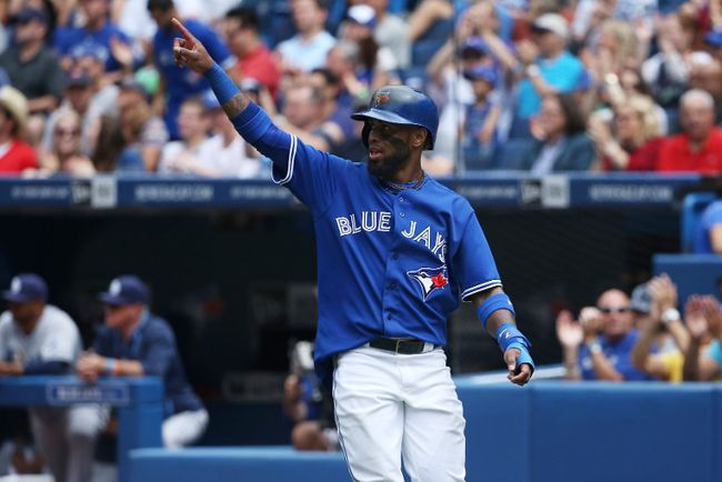 Jose Reyes of the Toronto Blue Jays salutes Melky Cabrera, who drove Reyes in with a double in the third inning during MLB game action against the Tampa Bay Rays on August 23, 2014 at Rogers Centre. (Tom Szczerbowski/Getty Images/AFP)