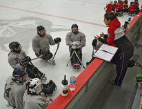 Tara Chisholm, head coach of the Canadian women's sledge hockey team talks to players hoping to make the national team, on Sunday, August 24, 2014 at the Brant Sports Complex in Paris, Ontario. BRIAN THOMPSON/BRANTFORD EXPOSITOR/QMI Agency