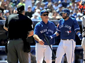 Toronto Blue Jays manager John Gibbons moves in between umpire Bill Welke and right fielder Jose Bautista after Bautista was tossed for arguing a strike three call in the sixth inning of the Jays 2-1 loss to the Tampa Bay Rays at Rogers Centre. (Dan Hamilton-USA TODAY Sports)