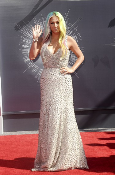 """BEST (with reservations): Kesha in Johanna Johnson.Just like Araiana, this was another style switheroo we didn't see coming. The soft, beaded dress doesn't seem like something Kesha would have in her closet, but she looked beautiful, rainbow hair and all. (Apega/WENN.com)  PDRTJS_settings_7794958 = { """"id"""" : """"7794958"""", """"unique_id"""" : """"default"""", """"title"""" : """""""", """"permalink"""" : """""""" }; (function(d,c,j){if(!document.getElementById(j)){var pd=d.createElement(c),s;pd.id=j;pd.src=('https:'==document.location.protocol)?'https://polldaddy.com/js/rating/rating.js':'http://i0.poll.fm/js/rating/rating.js';s=document.getElementsByTagName(c)[0];s.parentNode.insertBefore(pd,s);}}(document,'script','pd-rating-js'));"""