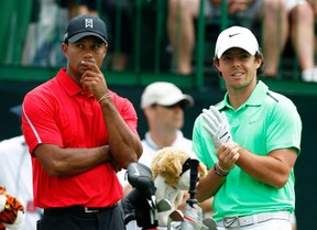 Tiger Woods of the U.S. talks to Rory McIlroy of Northern Ireland on the tee of the 12th hole during the final round of the Memorial Tournament at Muirfield Village Golf Club in Dublin, Ohio in this file photo from June 2, 2013.  (REUTERS)