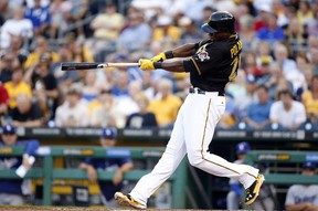 Pittsburgh Pirates right fielder Gregory Polanco (25) hits a solo home run against the Los Angeles Dodgers during the third inning at PNC Park. (Charles LeClaire-USA TODAY Sports)