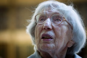 """Miriam Moskowitz talks to the media after a status conference in her case outside the Manhattan Federal Court building in the Manhattan borough of New York August 25, 2014. The 98-year-old retired New Jersey math teacher implicated in a Cold War atomic espionage case has asked a U.S. judge to throw out her 1950 conviction and fix a McCarthy-era """"miscarriage of justice"""" of which she is the last surviving victim. REUTERS/Carlo Allegri"""
