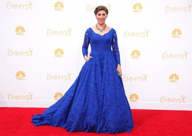 """Star: Mayim Bialik Grade: CWish we could give Mayim aka Amy on 'The Big Bang Theory' a higher grade because this cobalt blue is simply gorgeous. Unfortunately, the large skirt and long sleeves were all too much. (REUTERS/Lucy Nicholson)  PDRTJS_settings_7795758 = { """"id"""" : """"7795758"""", """"unique_id"""" : """"default"""", """"title"""" : """""""", """"permalink"""" : """""""" }; (function(d,c,j){if(!document.getElementById(j)){var pd=d.createElement(c),s;pd.id=j;pd.src=('https:'==document.location.protocol)?'https://polldaddy.com/js/rating/rating.js':'http://i0.poll.fm/js/rating/rating.js';s=document.getElementsByTagName(c)[0];s.parentNode.insertBefore(pd,s);}}(document,'script','pd-rating-js'));"""