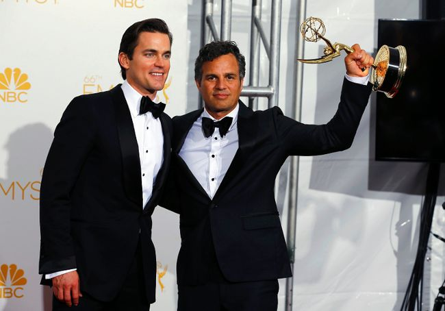 """Actors Matt Bomer (L) and Mark Ruffalo pose with their Outstanding Television Movie award for HBO's """"The Normal Heart"""" at the 66th Primetime Emmy Awards in Los Angeles, California August 25, 2014.  (REUTERS/Mike Blake)"""