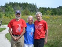 From left to right are Bill Moses, Owen Sound Parkinson SuperWalk volunteer, Lynn and Harvey Sandbrook, long time volunteers.