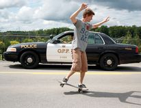 Jeffrey Nolan attempts a 'nose manual' skateboarding stunt in hopes of once again entering the Guinness Book of World Records. Nolan had help from the Ontario Provincial Police to hold traffic on North Augusta Road in Brockville as he made his attempt (Submitted photo).