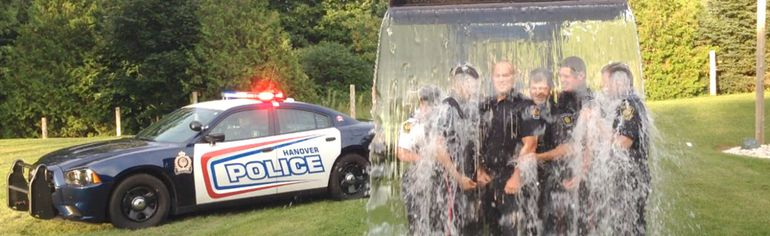 Sunday in Hanover, local emergency services personnel answered the call and got wet for a great cause. Hanover Police Service was challenged by the Hanover Fire Department and subsequently got drenched. Pictured in the photo, from left to right, is chief Tracy David, auxiliary constable Andrew Dennie, constable Ian Sanderson, constable Ryan Cabral, auxiliary constable Barrett Weber and inspector Chris Knoll. To make a donation to ALS Canada visit als.ca/en/donate. (Photo submitted)