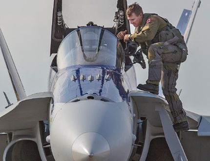 <p>RCAF Captain Adam Runge climbs in to his CF-18 Hornet on Tuesday, August 26, 2014 as he gets ready to perform for people attending a fundraising dinner at the Brantford Airport in support of Wednesday's Rotary Charity Airshow.</p><p>BRIAN THOMPSON/BRANTFORD EXPOSITOR/QMI Agency