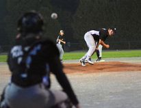 Jamie Haskett throws a pitch to the catch of the Delhi bantam house league baseball team. The pitching mound Haskett is standing on was installed only for one week for Delhi Minor Ball's year-end tournaments. It was removed on Aug. 25. (EDDIE CHAU Simcoe Reformer)