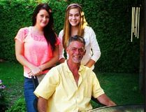 Brian Dunn with daughters Tara (left) and Ashley. Supplied Photo
