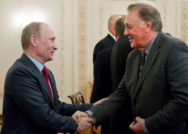 Russian Prime Minister Vladimir Putin greets former professional hockey player Phil Esposito in Moscow on February 24, 2012. (REUTERS/Misha Japaridze/Pool)