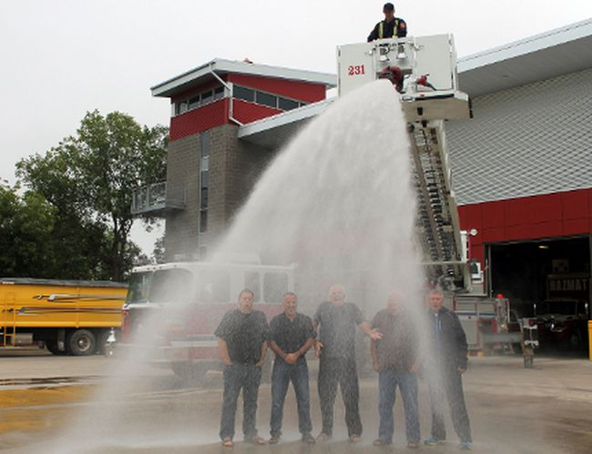 Left, city council members Henry Siemens, Don Friesen, Mayor Martin Harder, Ron Neisteter and Marvin Plett take part in the ALS Challenge. (JOEL NICKEL/Winkler Times)