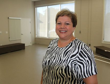 Andree Ferris, director of recreation services for Loyalist Township, stands inside one of the three activity rooms in the new leisure and activity centre that will open Sept. 7, featuring an increased number of programs for residents. (Michael Lea/The Whig-Standard)
