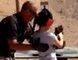 Shooting instructor Charles Vacca stands next to a 9-year-old girl at the Last Stop shooting range in White Hills, Arizona near the Nevada border, on August 25, 2014, in this still image taken from video courtesy of the Mohave County Sheriff's Office. The girl accidentally shot and killed her shooting instructor with an Israeli-made Uzi submachine gun when the weapon's strong recoil caused her to lose control of her aim, police said on Tuesday. (REUTERS/Mohave County Sheriff's Office/Handout via Reuters)