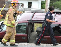 Const. Melanie Roach, of Sault Ste. Marie Police Service, investigates. Two vehicles went off the road following a collision at Gibbs Street and Eastern Avenue Friday morning. A minivan, westbound on Eastern, didn't stop at a stop sign, police say. That vehicle hit a pickup truck southbound on Gibbs. The driver of the van was taken to Sault Area Hospital with non-life-threatening injuries, said Const. Troy Miller of Sault Ste. Marie Police Service. Damage was severe to the van and moderate to the truck. Sarah Toivonen, 56, of 102 River Rd., was charged with fail to stop for a stop sign.