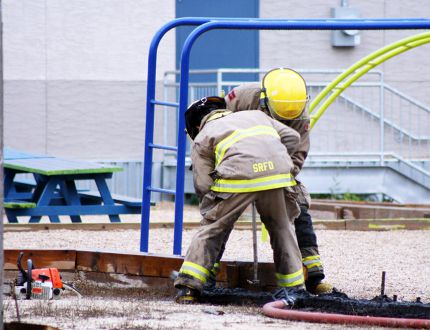 Stonewall-Rockwood firefighters put out a fire at the playground behind Balmoral School (Glen Hallick, The Stonewall Argus & Teulon Times, QMI Agency)