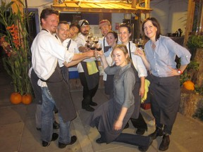 Chef Blair Lebsack (second from left) and his team celebrate with a glass of wine after last year's successful Nature's Nourishment dinner. - Photo Supplied